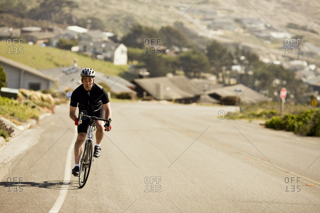 Cyclist cycling up a road