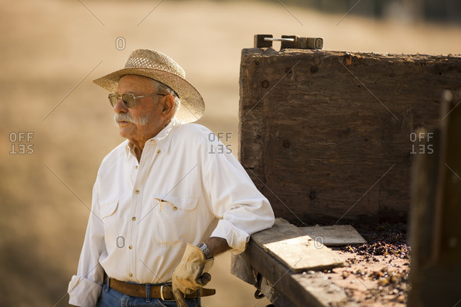 Rancher leaning on the back of his truck