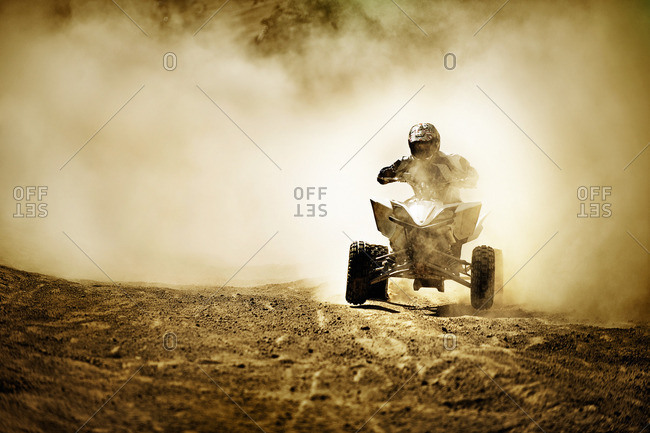 Person riding a quad bike on the dirt