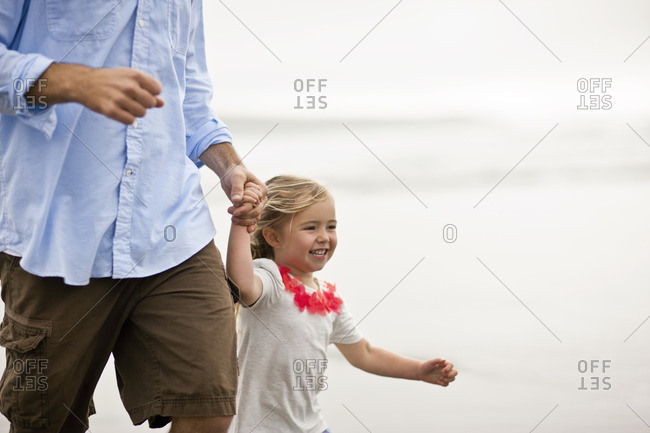 Father and daughter running hand in hand