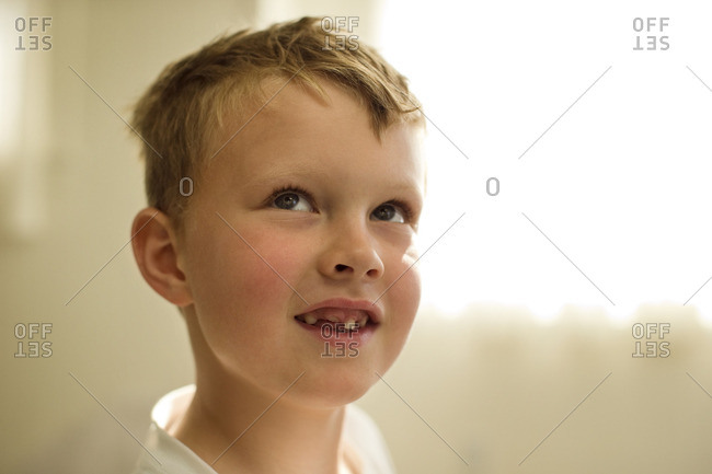 Young boy with a missing front tooth