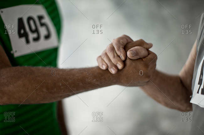 Competitors shaking hands during a running race