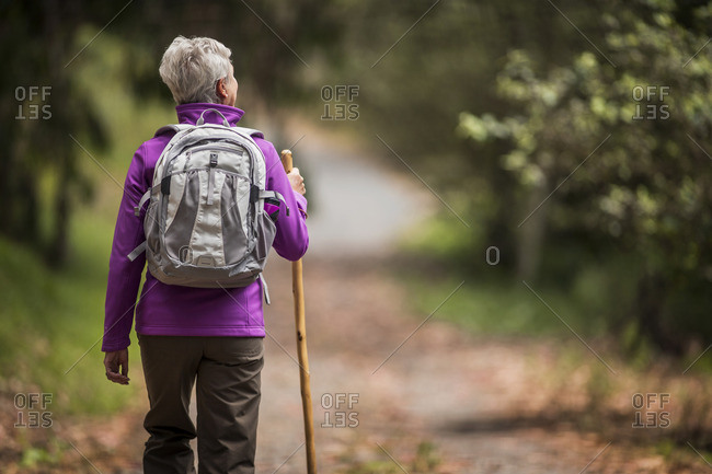 Woman walking on a rural footpath