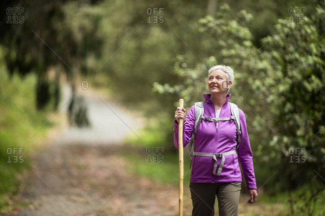 Woman walking on a rural footpath
