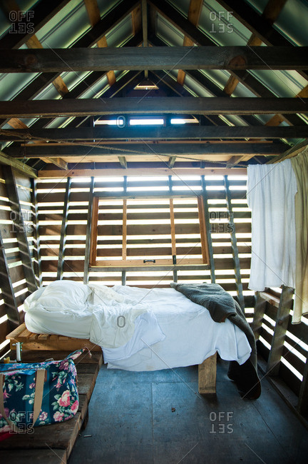 Beach Lake, Pennsylvania - August 4, 2012: Interior of small cottage with bed at the Mildred's Lane art complex