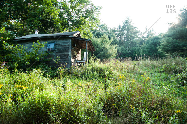 Beach Lake, Pennsylvania - August 4, 2012: A weathered cottage in rural field at the Mildred's Lane art complex
