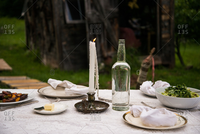 A rustic dinner table in rural setting