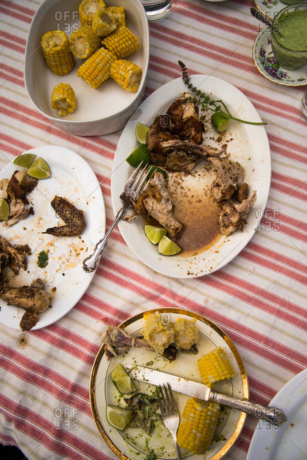 Chicken and corn dishes on table