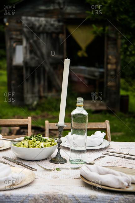 Dinner table set in rural setting