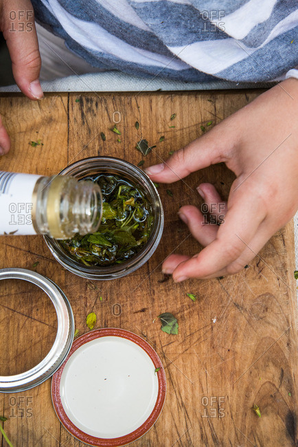Filling jar with herbs and liquid