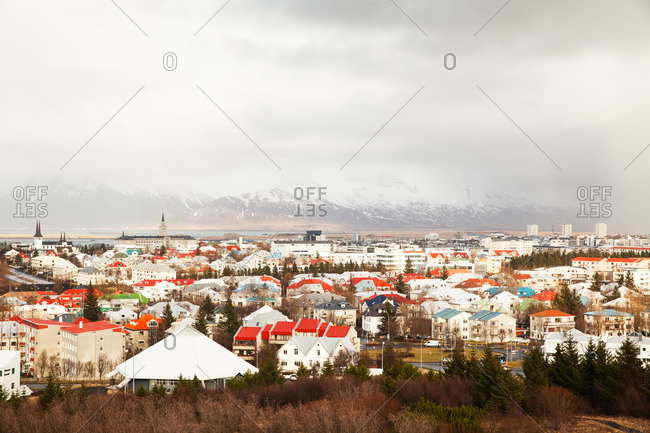 Colorful city rooftops and distant mountains in Reykjavik, Iceland