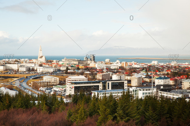 Reykjavik, Iceland - February 28, 2012: City skyline with colorful rooftops and distant mountains