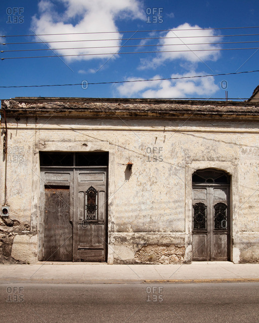Wooden doorways on an aged street side building in Merida, Mexico