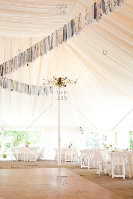 Blue floral and lacy fabric streamers hanging over the dance floor at a wedding reception