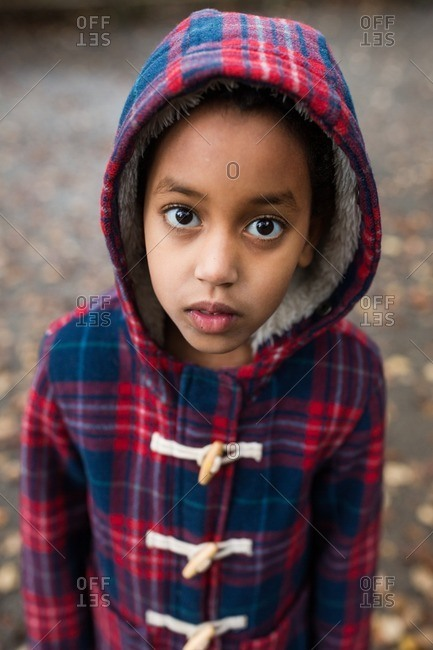 Girl in a plaid toggle coat