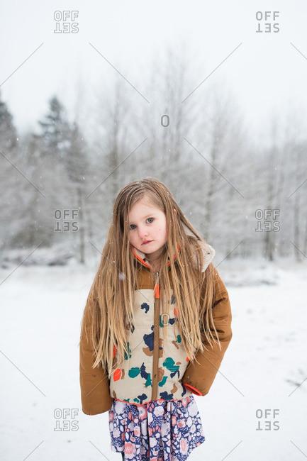 Girl with long hair in snowy field