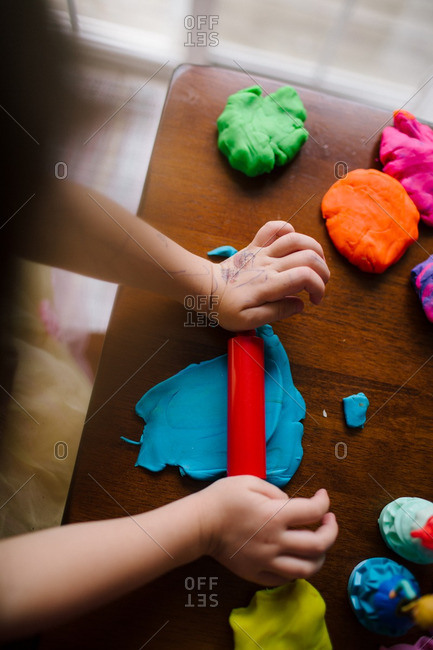 Child playing with modeling clay
