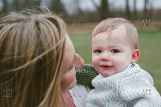 Portrait of baby boy held by his mother