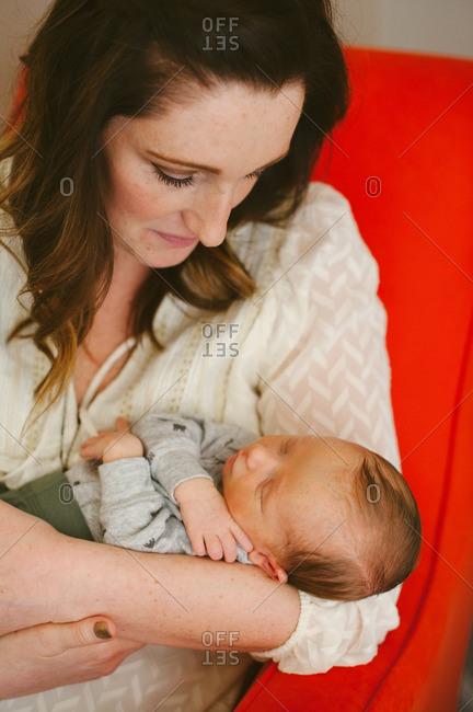 Portrait of mother holding infant son