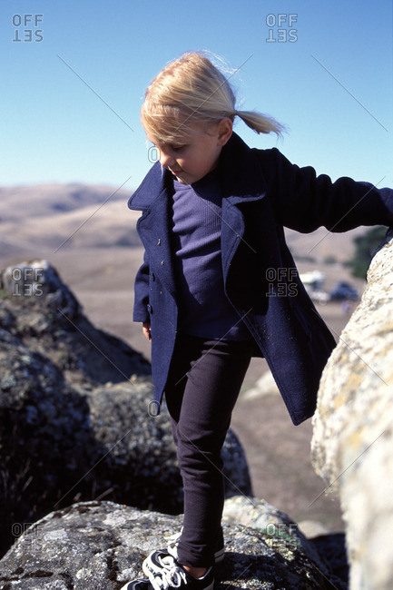 Young girl exploring in the rocks.
