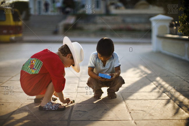 Two young boys playing together.