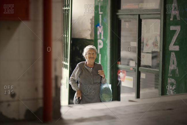 Smiling senior woman out shopping.