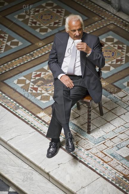 Senior businessman taking a coffee break.
