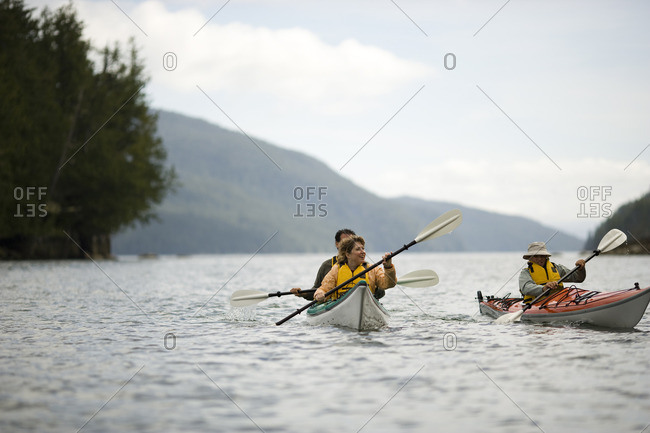 People kayaking together on a scenic lake.
