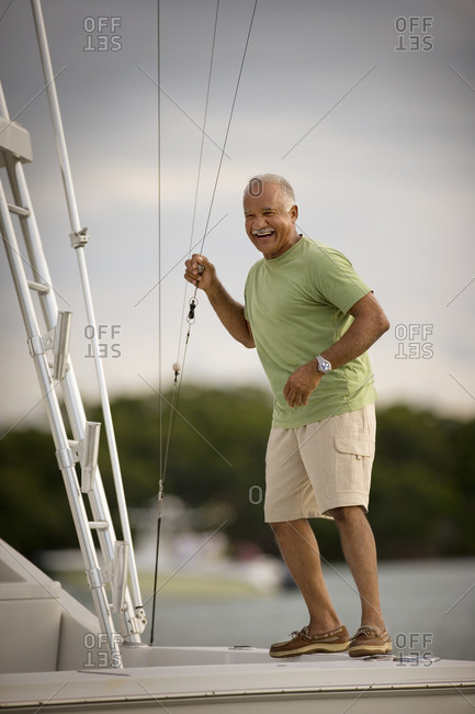 Mature man enjoying a boat trip.