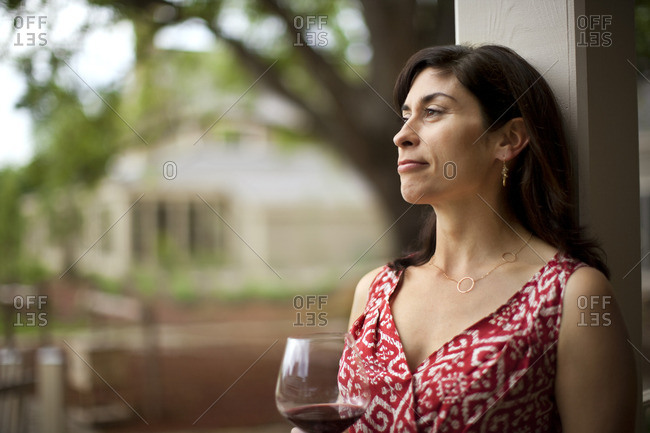 Woman relaxing with a glass of wine.