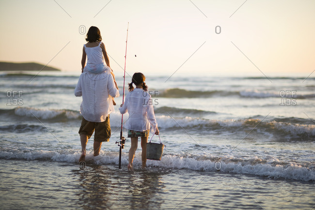 Father fishing with his two daughters.