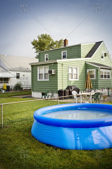 Paddling pool in the yard of a house.