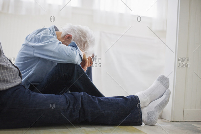 Couple sitting in their hallway after doing some DIY.
