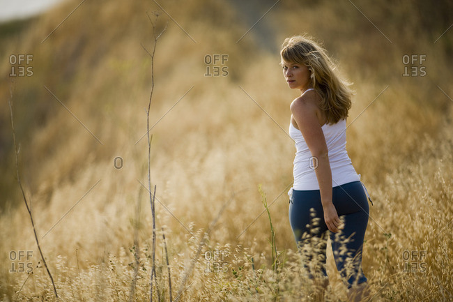 Young woman walking in a meadow.