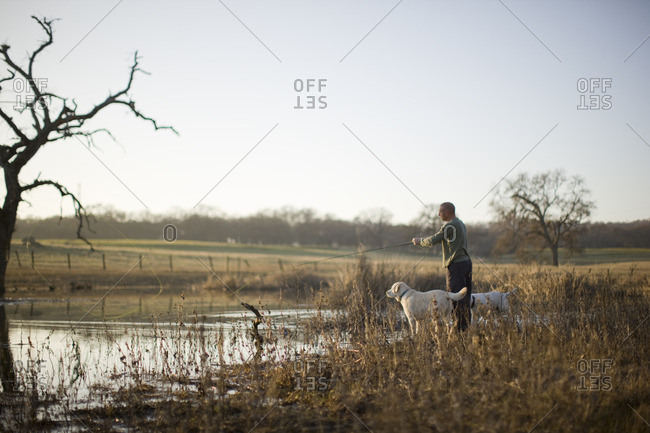 Man fishing with his dog.