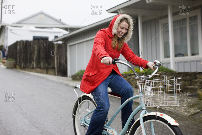Young woman riding her bike down the street.