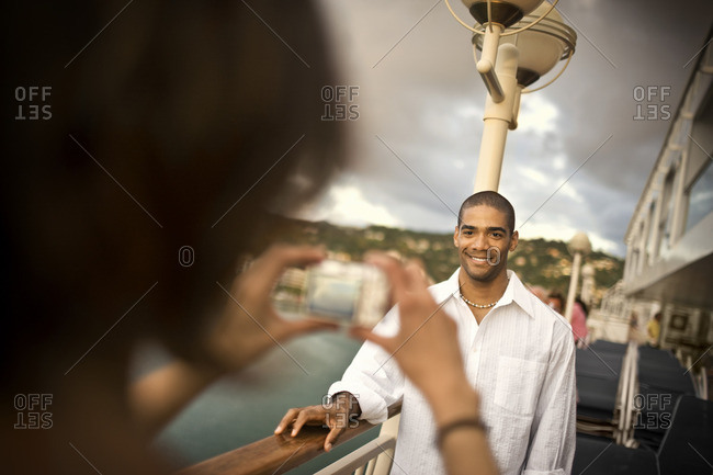 Woman photographing her partner on a boat.