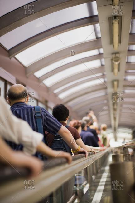 Commuters on the subway escalator.