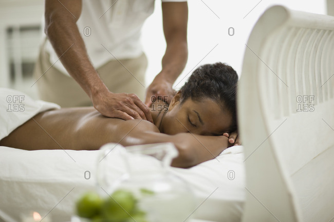 Young woman receiving a massage.