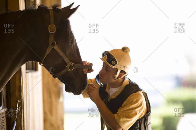 Jockey tending to his horse.