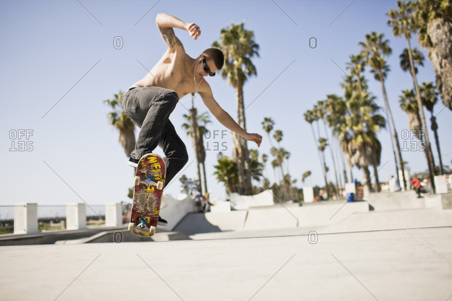 Skateboarder performing a trick at the skate park.