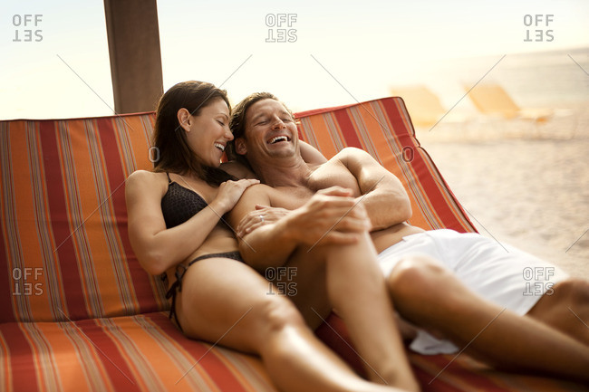 Happy couple relaxing together on vacation.