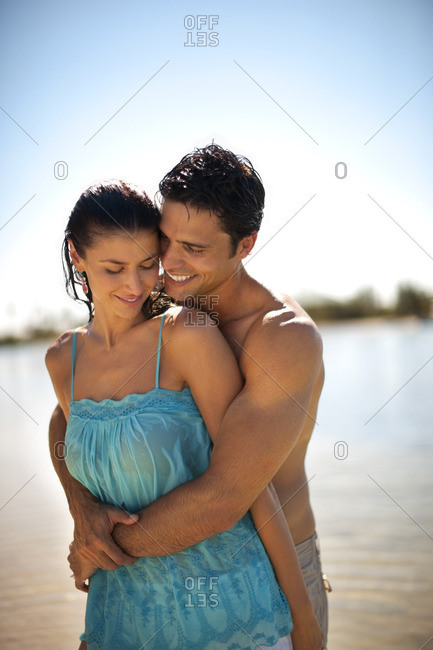 Young couple embracing on the beach.