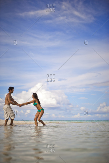 Young couple having fun at the beach.