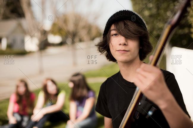 Teenage boy with a guitar.