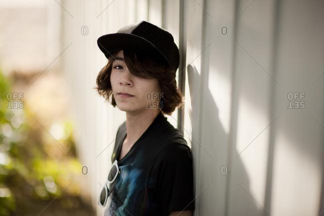 Teenage boy in a baseball cap.