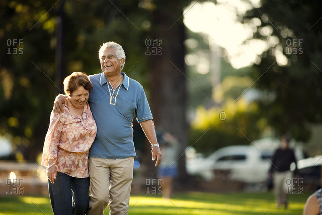 Senior couple walking together in the park.