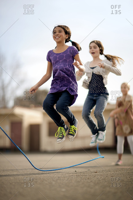Young girls jumping rope.