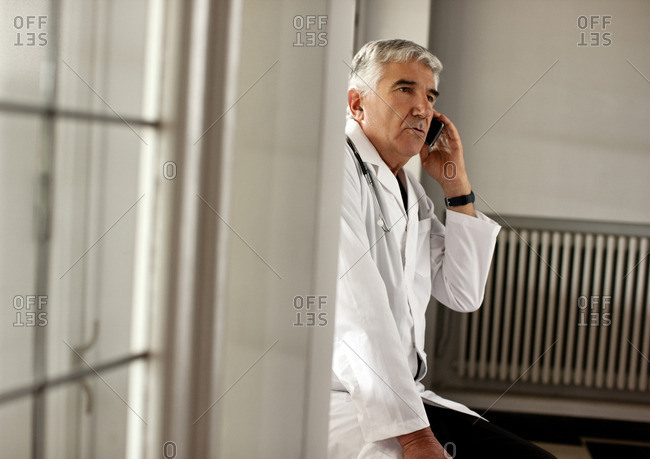 Doctor talking on his cellphone.