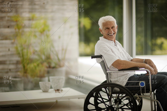 Smiling senior man in a wheelchair.
